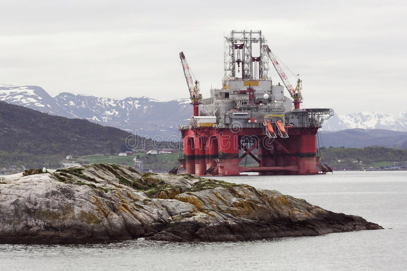 Oil rig. In norwegian fjord landscape royalty free stock photo