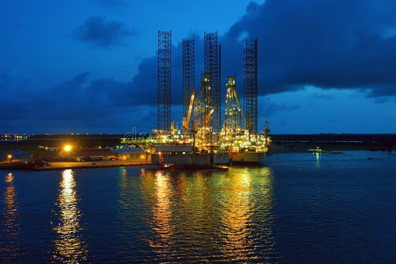 Oil rig at dusk stock photos