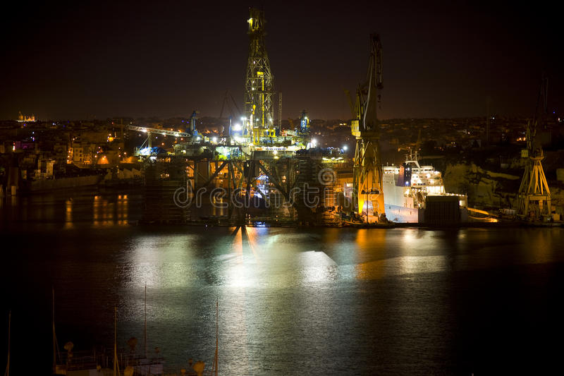 Download Oil Rig at night Malta stock image. Image of crane, dusk - 30102093
