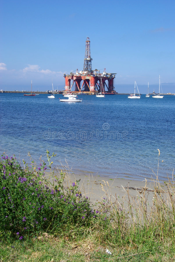 """Oil Rig Near Shore. The rare sight of the """"Ocean Patriot"""" oil rig docked close to the coast. It was towed in for maintenance and refurbishment. Portland stock photos"""