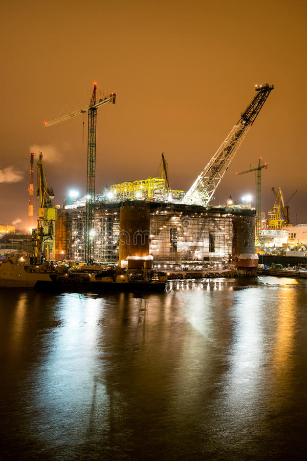 Oil rig. Night view of the renovation of an oil rig in the Gdansk Repair Shipyard royalty free stock photography