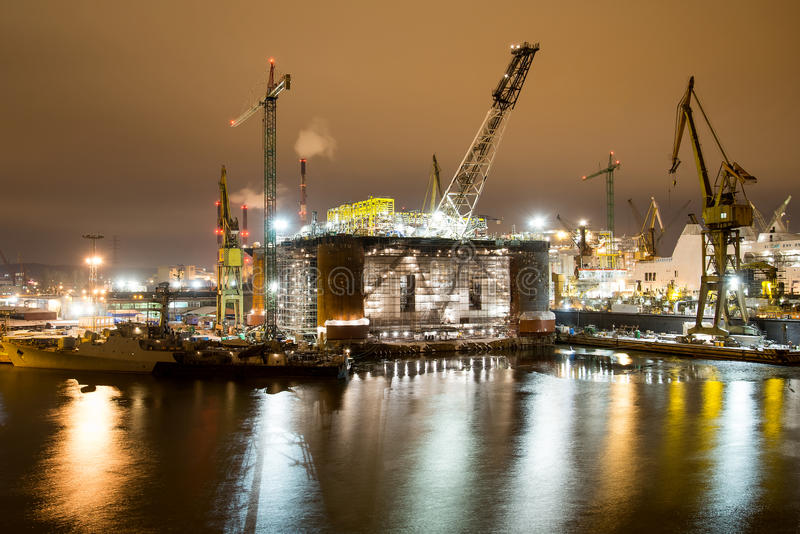 Oil rig. Night view of the renovation of an oil rig in the Gdansk Repair Shipyard stock photography
