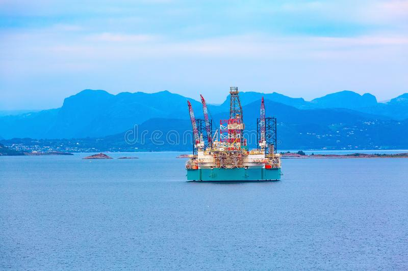 Oil platform in Norway, Stavanger. Oil rig, offshore platform in Stavanger, Norway fjord with copy space royalty free stock photography