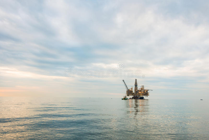 Oil rig platform. In the calm sea royalty free stock image