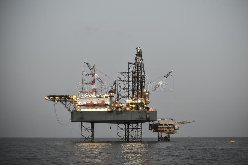 Oil and rig platform operation in north sea, Heavy industry in oil and gas business in offshore, rig operation.  royalty free stock photo