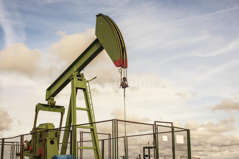 Oil rig pumping royalty free stock image