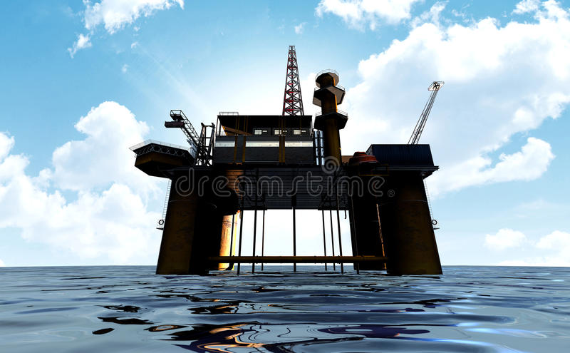 Oil Rig. A regular view of an oil rig out at sea on a blue cloudy sky background royalty free stock photo