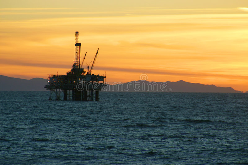 Oil Rig Sunset royalty free stock photography