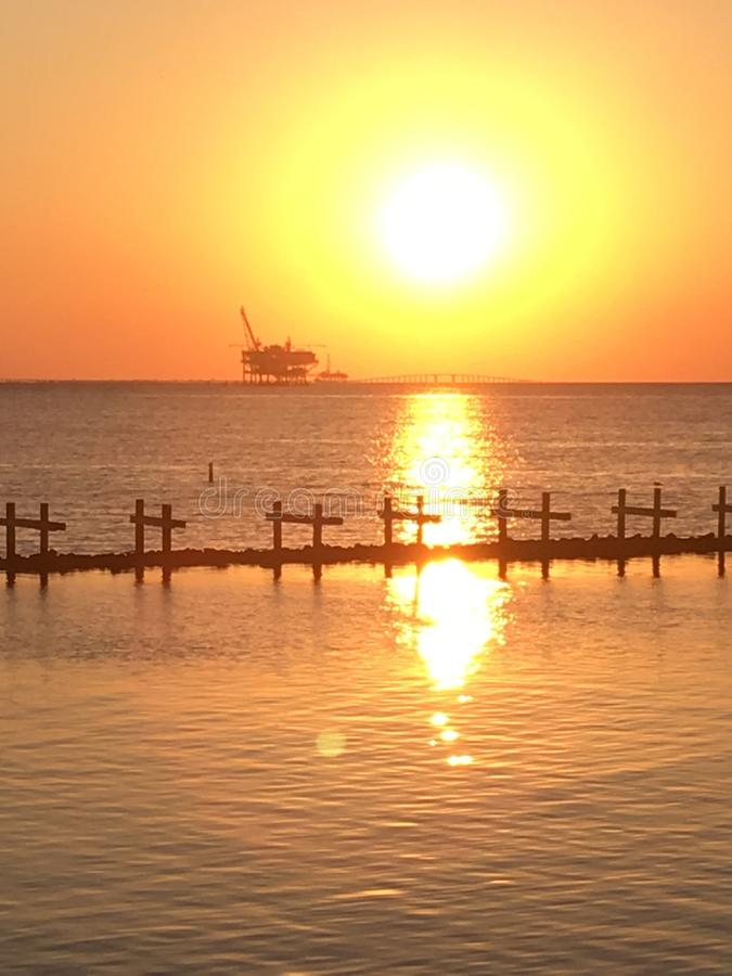 Oil rig sunset. View of gulf oil rig at sunset stock image