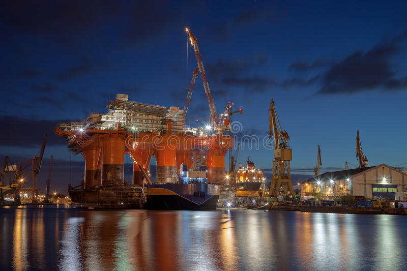 Oil rig in the yards stock photos