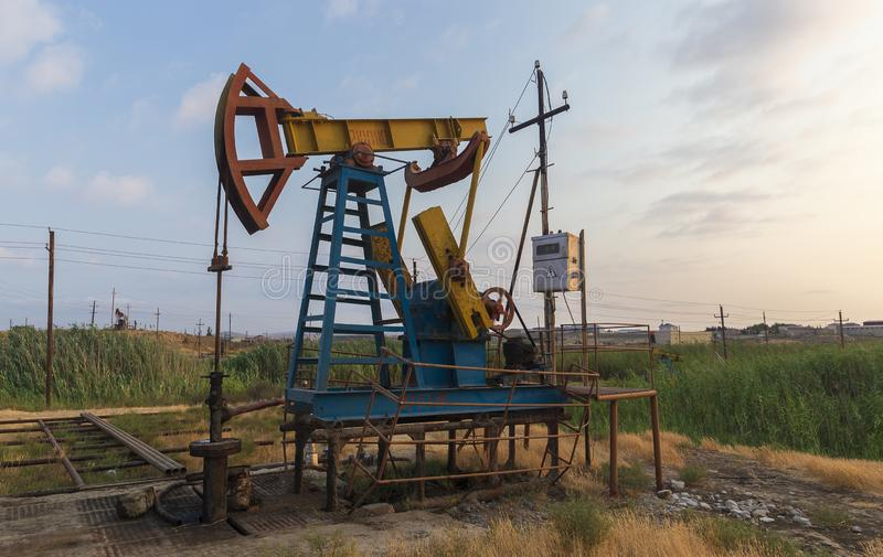 Oil rocking at sunset. Object royalty free stock images