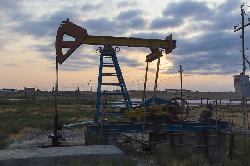 Oil rocking at sunset. Object stock photo