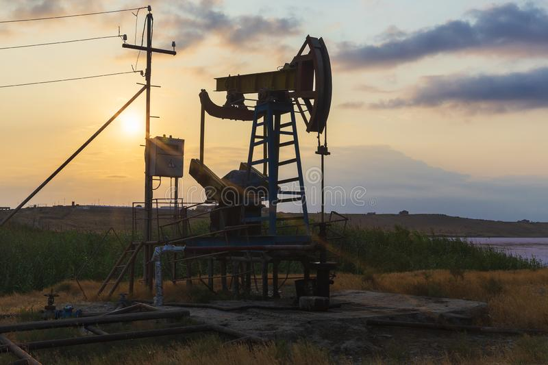 Oil rocking at sunset. Object royalty free stock image