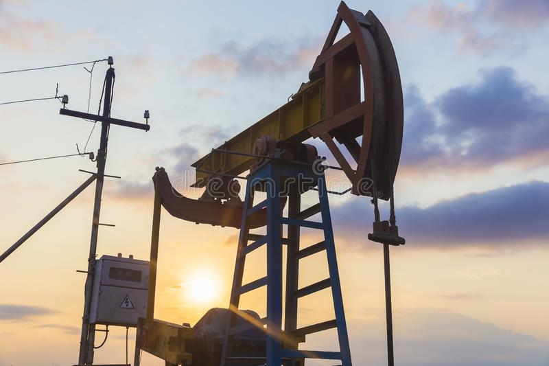 Oil rocking at sunset. Object stock images