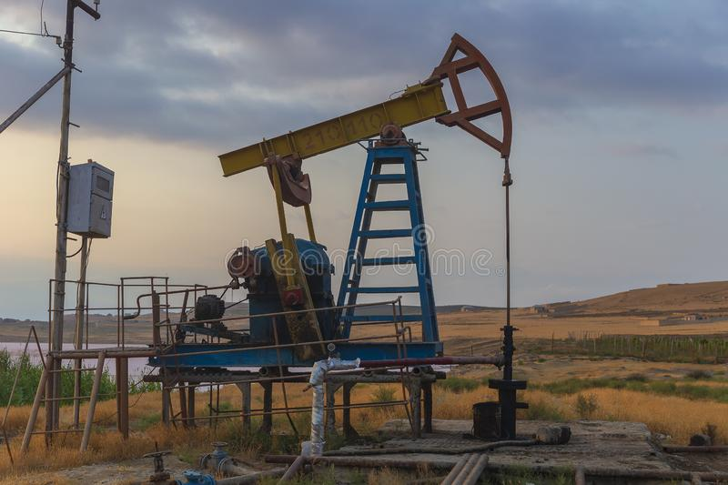 Oil rocking at sunset. Object stock image