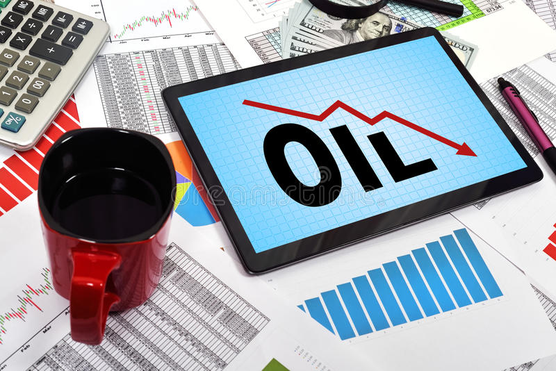 Oil sanctions. Digital tablet with oil sanctions on the table businessman stock photo