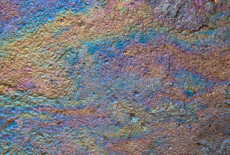Oil sheen from spilled on ground wet.  royalty free stock photos