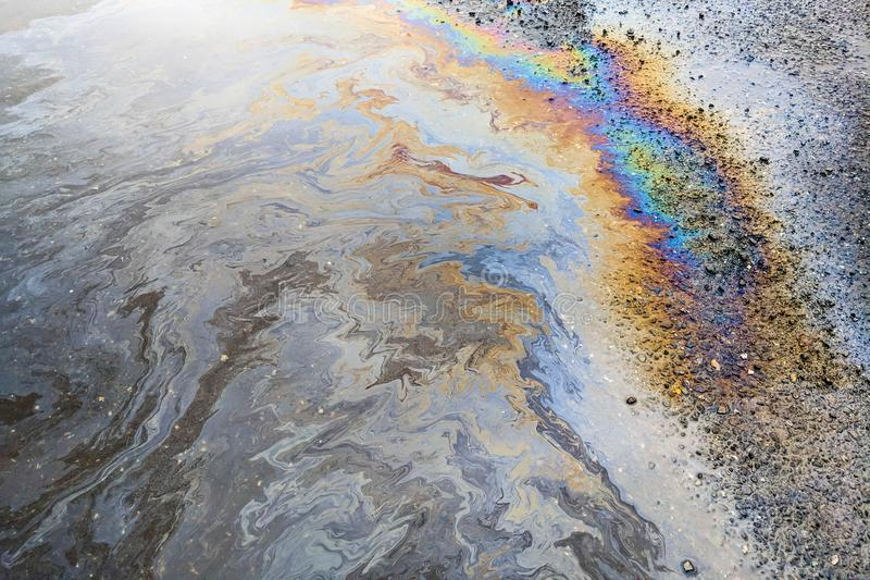 Oil Sheen on Water. Rainbow colors from an oily sheen on water royalty free stock photography