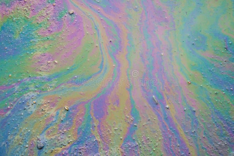 Oil Slick. Background of an oil slick on the asphalt stock photography