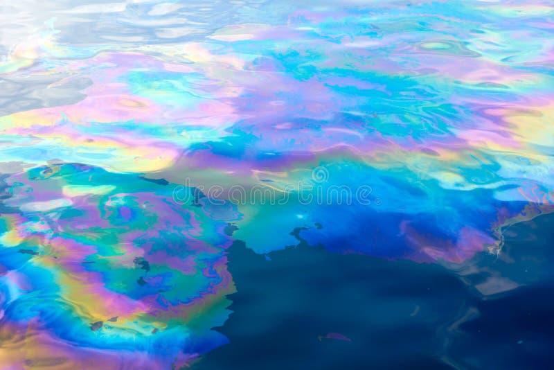 Oil slick creates Rainbow Colors on Water royalty free stock photos