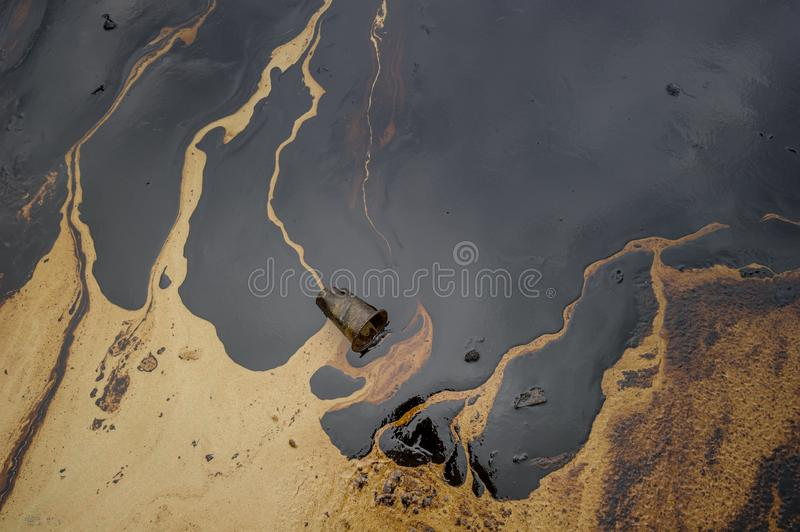 Oil sludge contaminating the sea during the oil spill disaster in Samet Island, Rayong, Thailand.  royalty free stock image