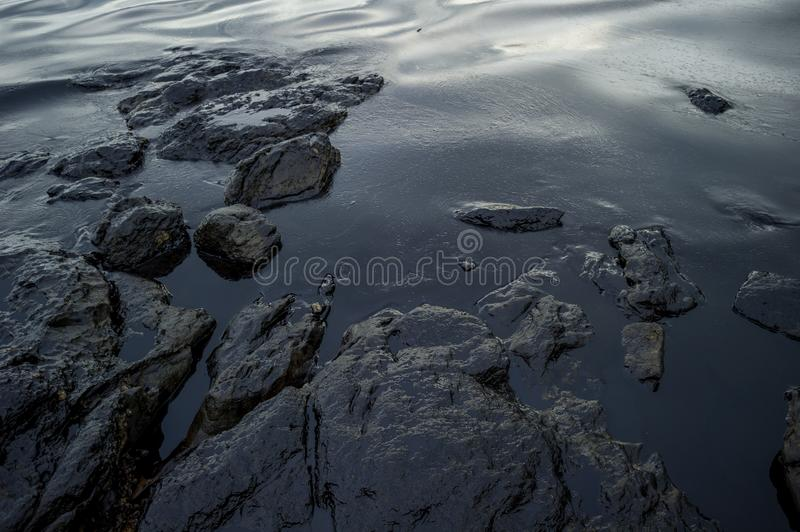 Oil sludge contaminating the sea during the oil spill disaster in Samet Island, Rayong, Thailand.  stock images