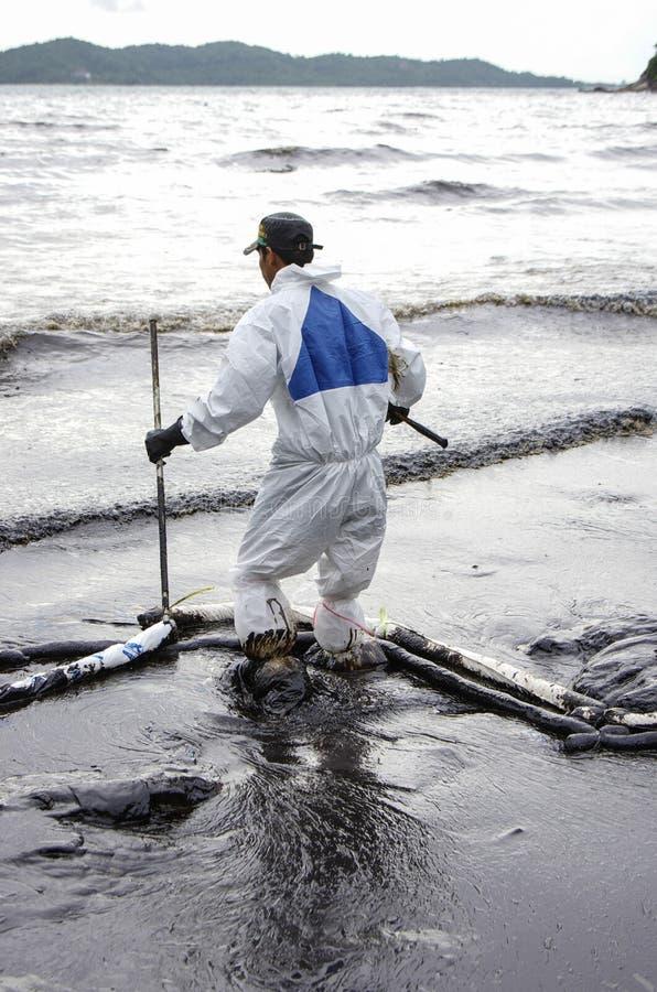 Oil spill on the Ao Prao beach, Koh Samet Island. royalty free stock image