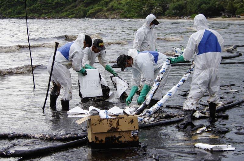 Oil spill on the Ao Prao beach, Koh Samet Island. stock photos
