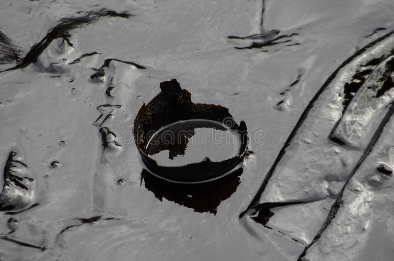 Oil spill on the Ao Prao beach, Koh Samet Island. stock photography