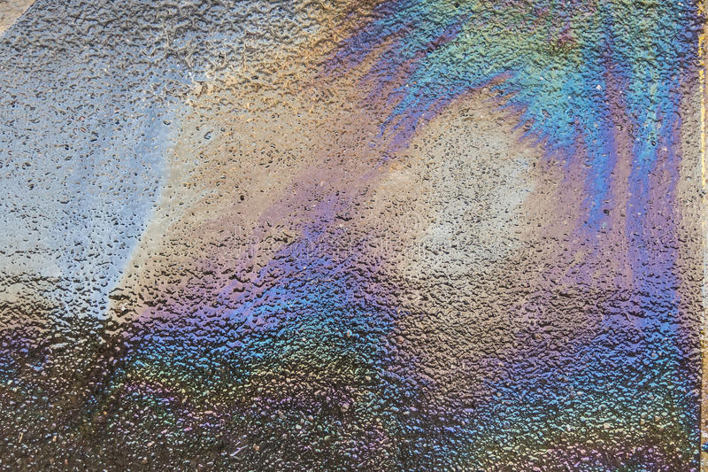 Oil spill on asphalt. Road as texture or background stock images
