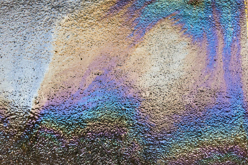 Oil spill on asphalt road royalty free stock image