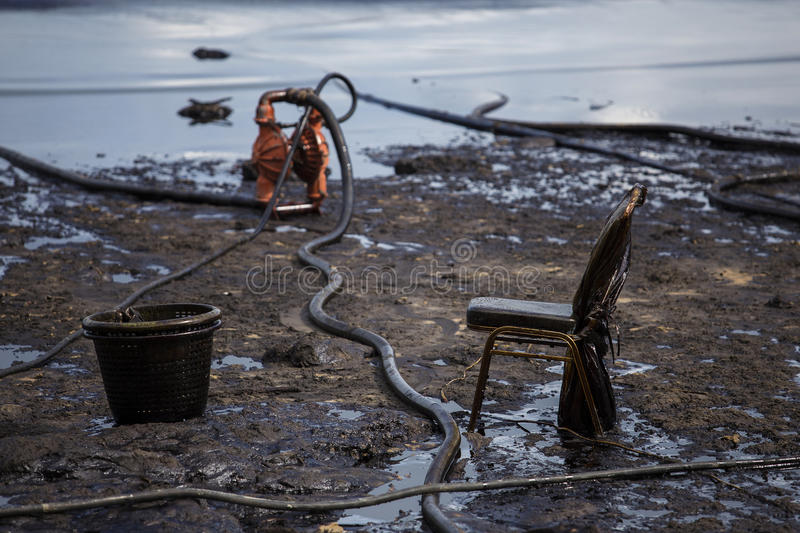 Oil spill on the beach. At Ao Prao Beach, Koh Samet, Rayong, Thailand stock image