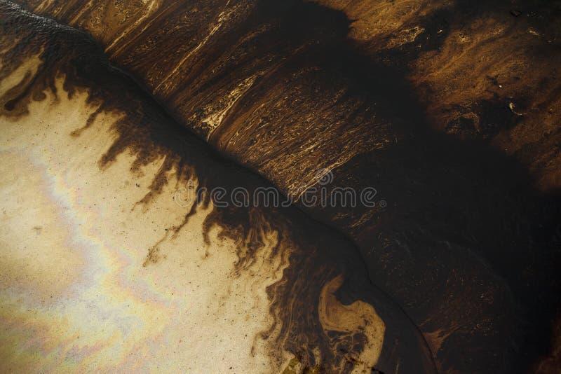 Oil spill on beach stock photography
