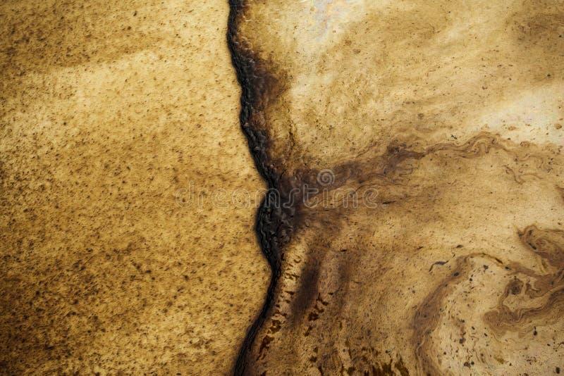 Oil spill on beach stock photo