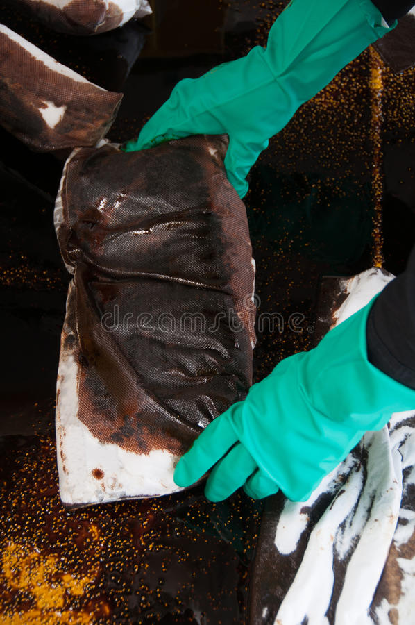 Oil spill cleanup on working area. danger for the nature.  stock photos