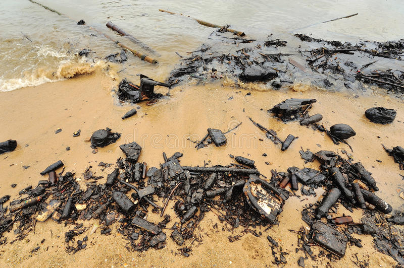 Oil spill. Contaminated Beach. stock photography