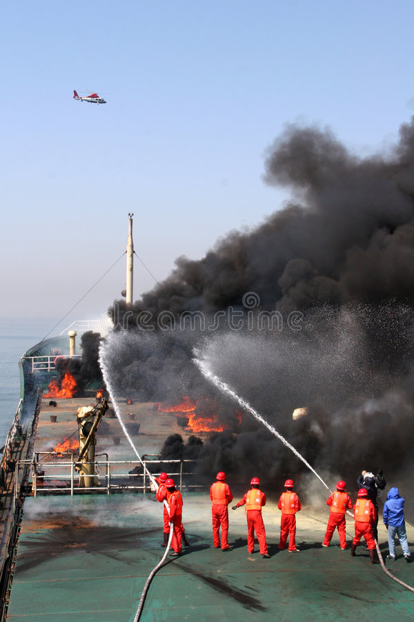 Oil spill contingency exercise. This is an oil spill contingency exercise which was organized by the former Ministry of Communications in China.It was simulation stock photo