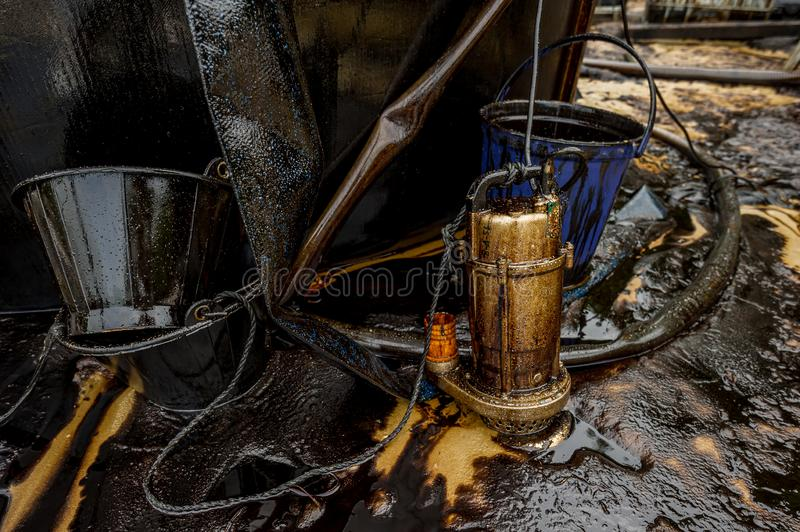 Oil spill diaster - Greasy oil tools and polluting environment at Samet Island, Rayong, Thailand. Oil spill diaster - Greasy oil tools and polluting environment royalty free stock images
