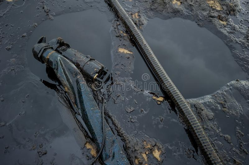 Oil spill diaster - Greasy oil tools and polluting environment at Samet Island, rayong, thailand.  stock image