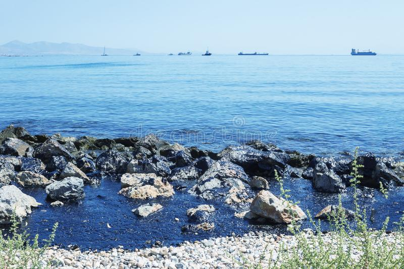 Oil spill. Environmental disaster. island of Salamis. royalty free stock photo