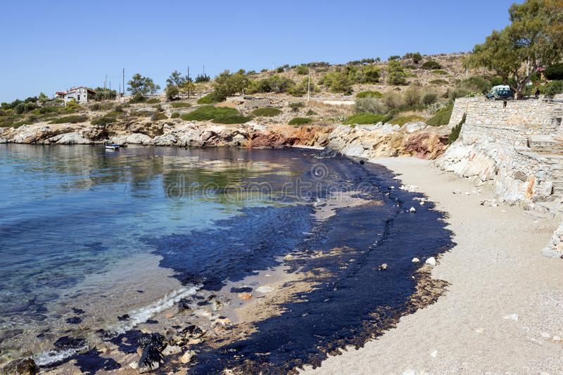 Oil spill. Environmental disaster. View of the polluted beach. royalty free stock photo