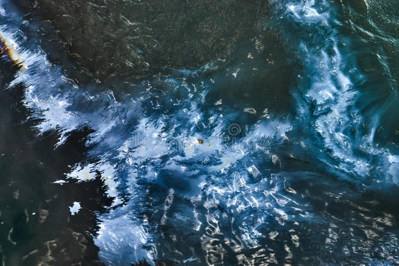 Oil spill on Sea water, top view stock image
