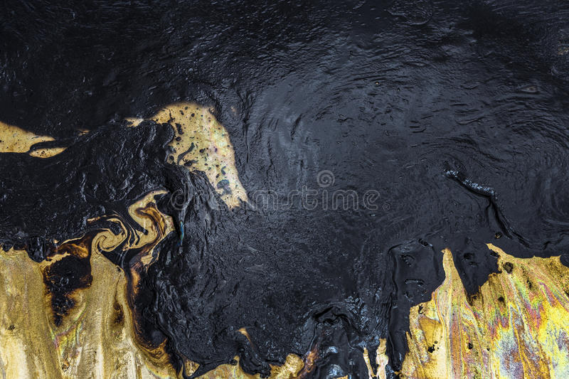 Oil spill texture on the sand beach. Texture of Crude oil spill on sand beach from oil spill accident stock image