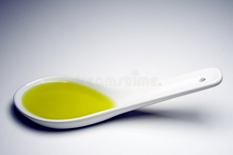 Oil on spoon royalty free stock photography