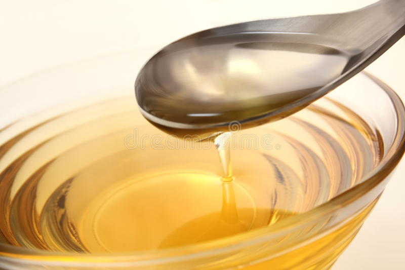 Oil with spoon royalty free stock photography