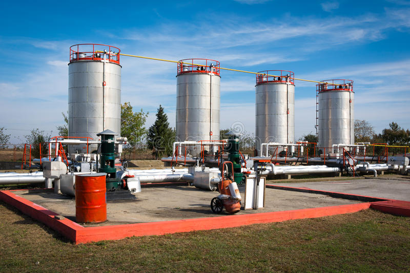 Oil storage and pipeline. On the blue sky royalty free stock image