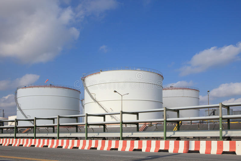 Oil storage tank in heavy petrochemical industry estate stock images