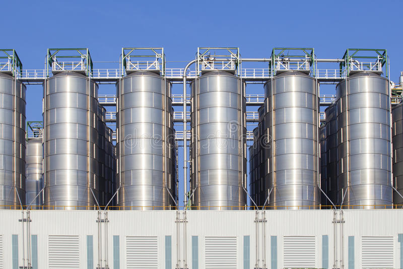 Oil storage tank in heavy petrochemical industry estate royalty free stock photo
