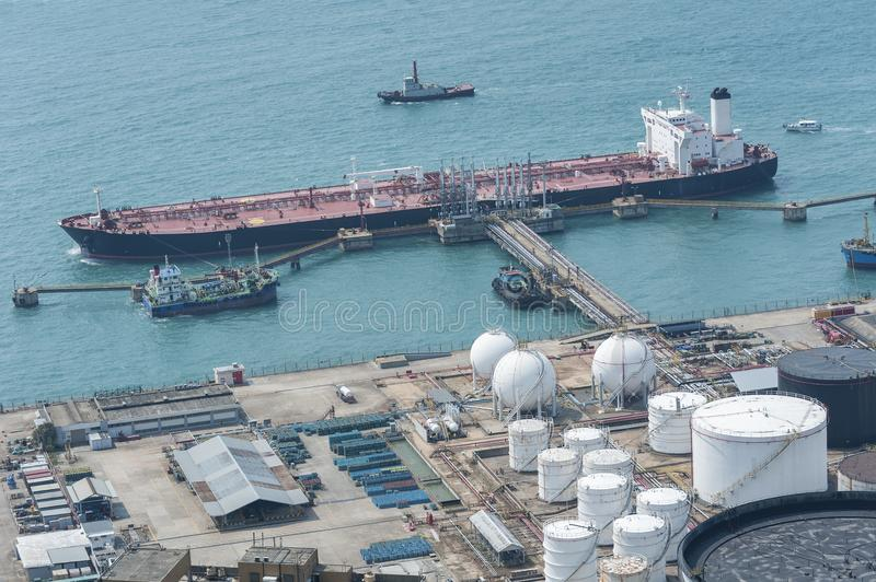 Oil Storage tank and oil tanker. In Hong Kong stock image