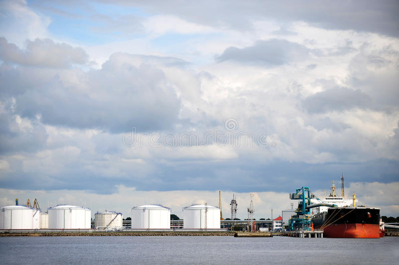 Oil Storage tanks. At harbor under cloudy sky stock photos